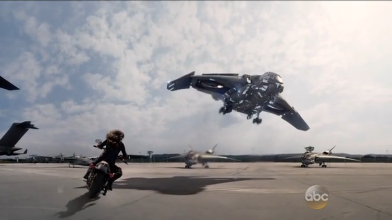 Quinjet activating cloak. Why didn't she catch a ride? Where did the motorcycle come from? No idea.
