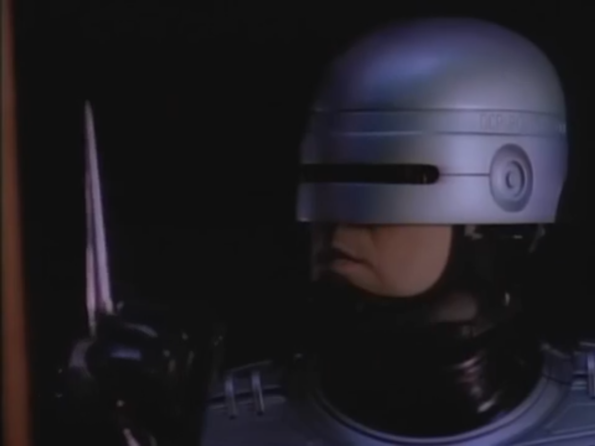 RoboCop, with his totally-nonlethal pointy stick attachment.