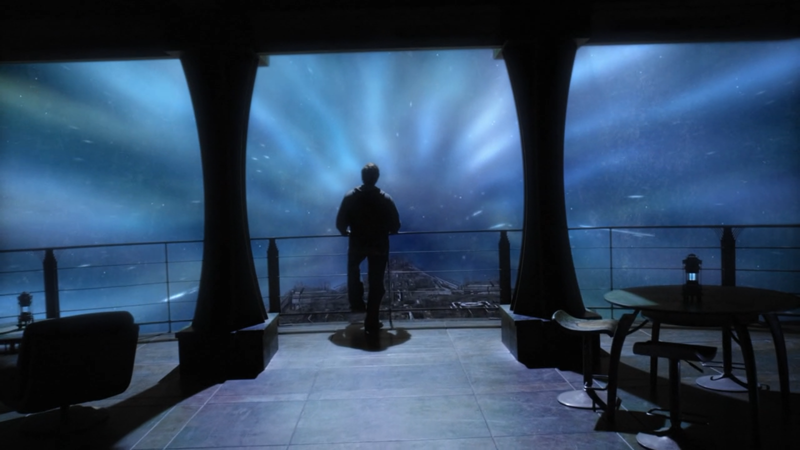 Eli looks out over a railing in a shot very similar to the last of Atlantis--but far more depressing.