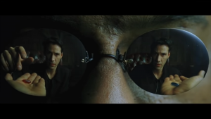 Neo chooses a pill, from the Matrix